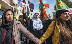 Women in Qamishlo, the de facto capital of Rojava, protest against a Turkish-Russian deal that threatens them and the gains of their revolution.Photo: Delil Souleiman/AFP/Getty