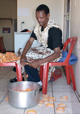 Men's work: Sonwabo Qathula works as a caregiver with the Siyakhanyisa HIV/AIDS support group in South Africa.