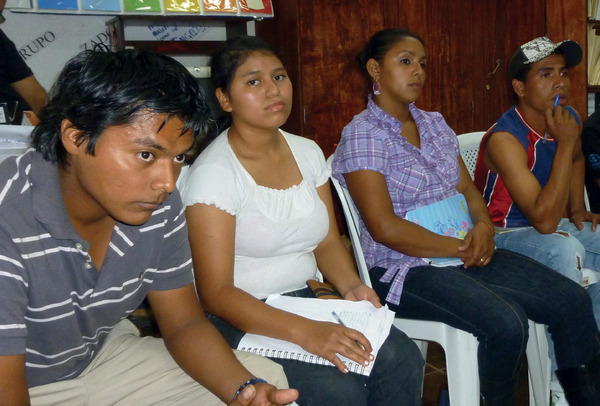 Serious business: young people in discussion with the author in El Salvador.