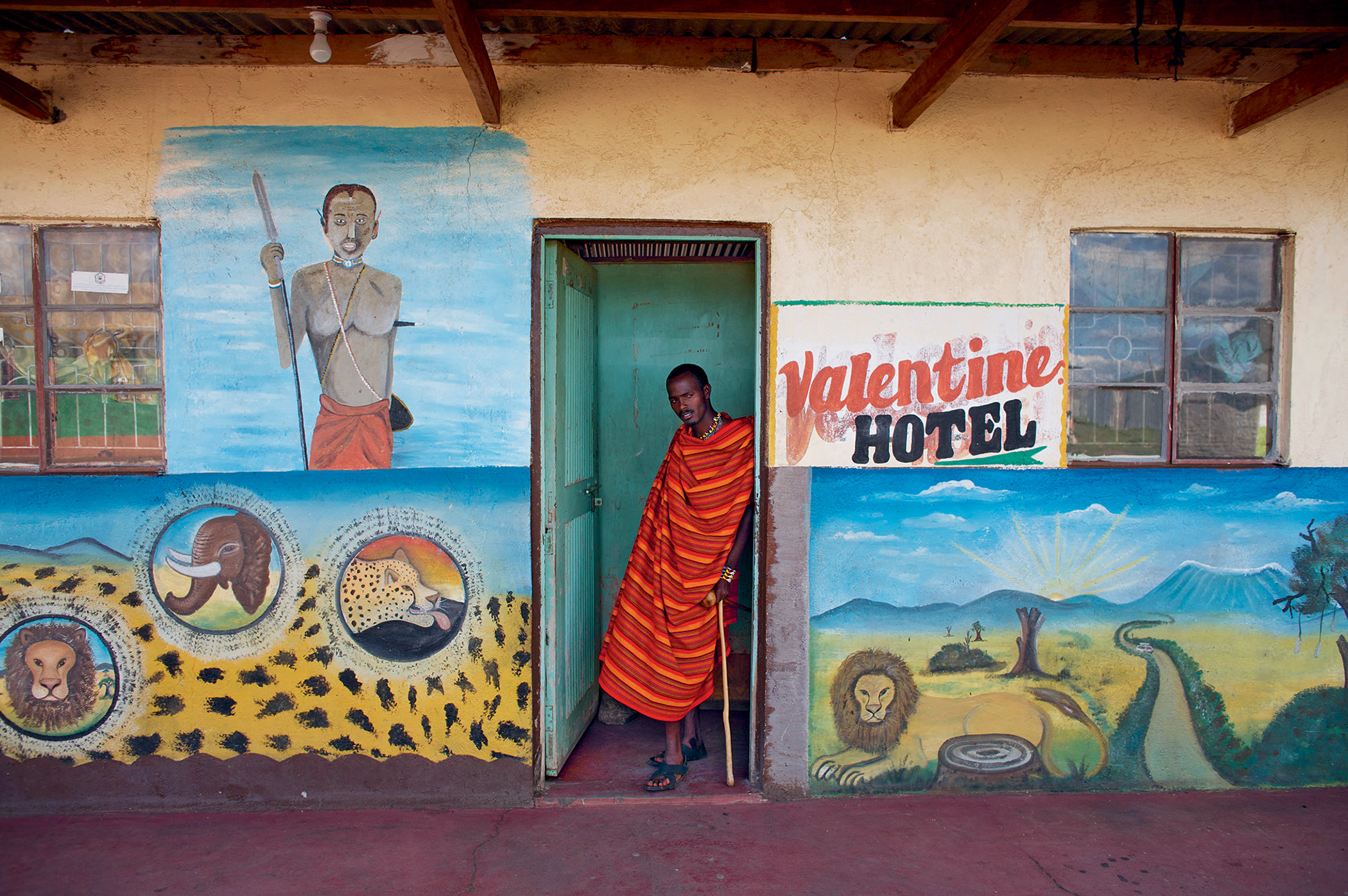 A Maasai man at a lodge on the tourist trail, Kenya. Maasai people are becoming participants in the tourist economy on their community-managed lands.