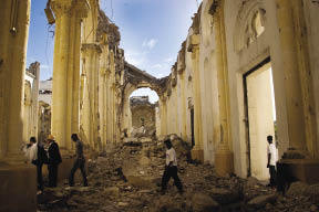 Churchgoers walk through the ruins of Notre Dame Cathedral in Port-au-Prince on the first anniversary of the 2010 earthquakeJacob Kushner