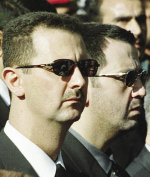 Family ties: Bashar and Maher al-Assad.