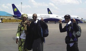 Jean and Patrick arrive at Kigali International airport. They are accompanied by Jean's sister Martha.
