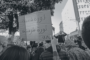 The placard reads 'popular revolution, legitimate revolution'.Photo: Chedly Ben Ibrahim/Nurphoto/PA Images