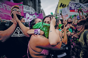 The moment they'd been hoping for: crowds held an overnight vigil outside Argentina's National Congress in Buenos Aires to await the outcome of the Senate's vote on abortion law. As the result came in there was mass celebration.Photo: Juan Ignacio Roncoroni/EFE/Alamy