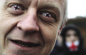 A hard-line look: an English Defence League supporter wears contact lenses sporting the St George cross – a symbol for some of white supremacy. Paul Hackett / Reuters