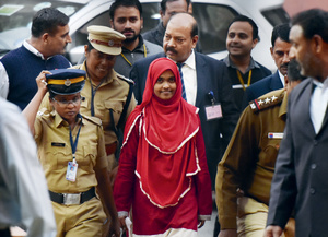 Hadiya, in the red dress, appears at the Supreme Court in New Delhi to defend her marriage to her Muslim husband Shafin in one of India's alleged 'love jihad' cases.Photo: Vipin Kumar/Hindustan Times Via Getty