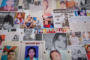 Photos and descriptions of missing loved ones, many thought to have been trafficked to India, cover a board at a border police station in Bhairahawa, Nepal. Once in India or overseas, it is extremely difficult for trafficked persons – a third of whom are children – to escape. They are usually held captive, do not know the language, cannot afford to travel home and in many cases are bonded to their captors by fabricated debt.Photo: Violeta Santos Moura