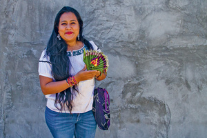 Libertad Gómez, who crossed the gender barrier to become adept in the traditional Zoque decorative artform of  making ceremonial offerings with mango leaves and flowers.Photo: Changiz M Varzi