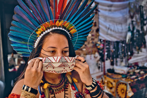Fighting on all fronts. Samela, a 23-year-old activist from the Association of the Satere-Mawe Indigenous Women in Manaus, Amazonas in Brazil, co-ordinates the production of protective face masks.Photo: Raphael Alves/IMF/Creative Commons