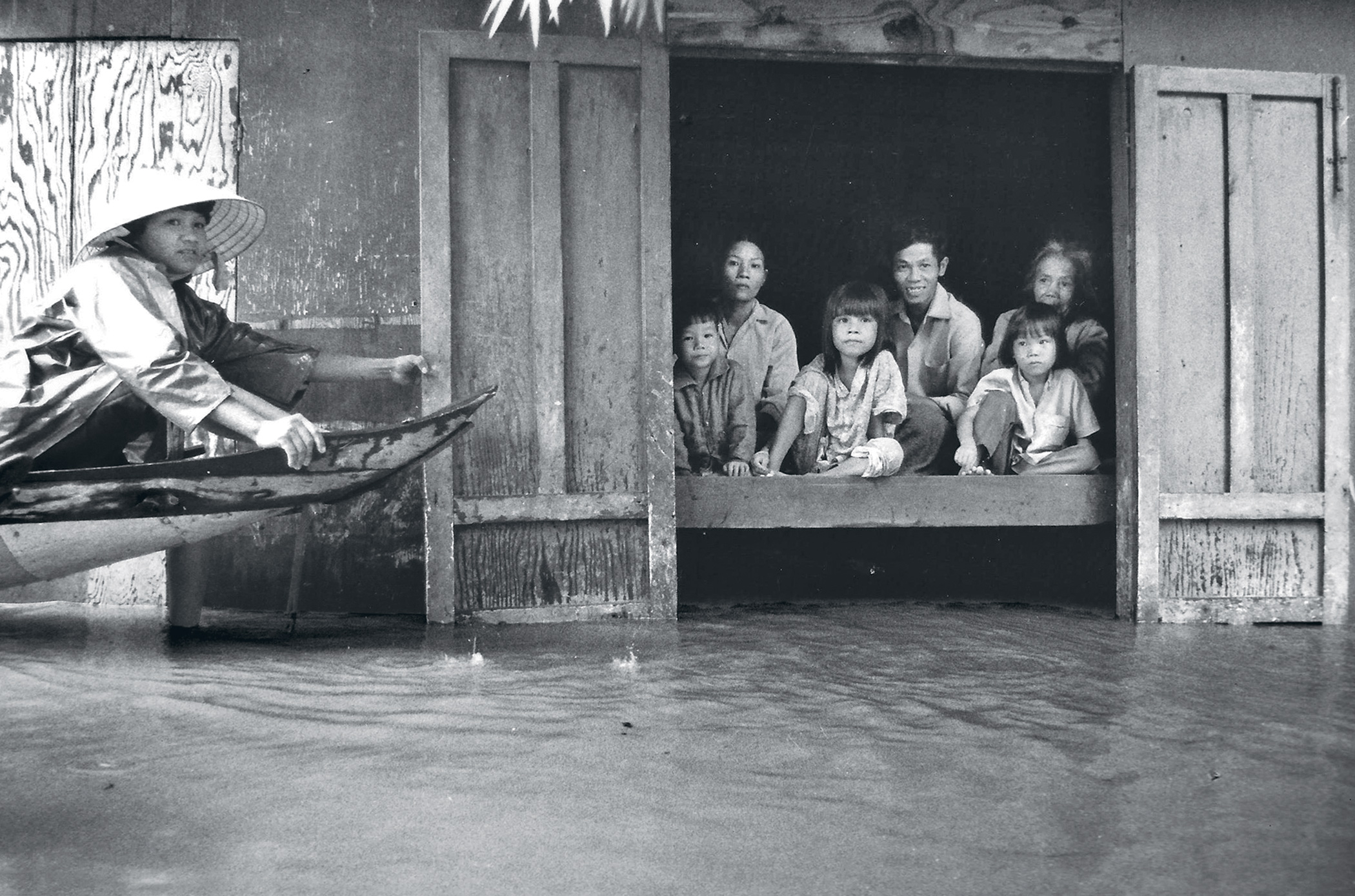 Lost in the flood. Interviewing a family trapped in their home in the aftermath of a typhoon in Huê, Vietnam, in 1991.