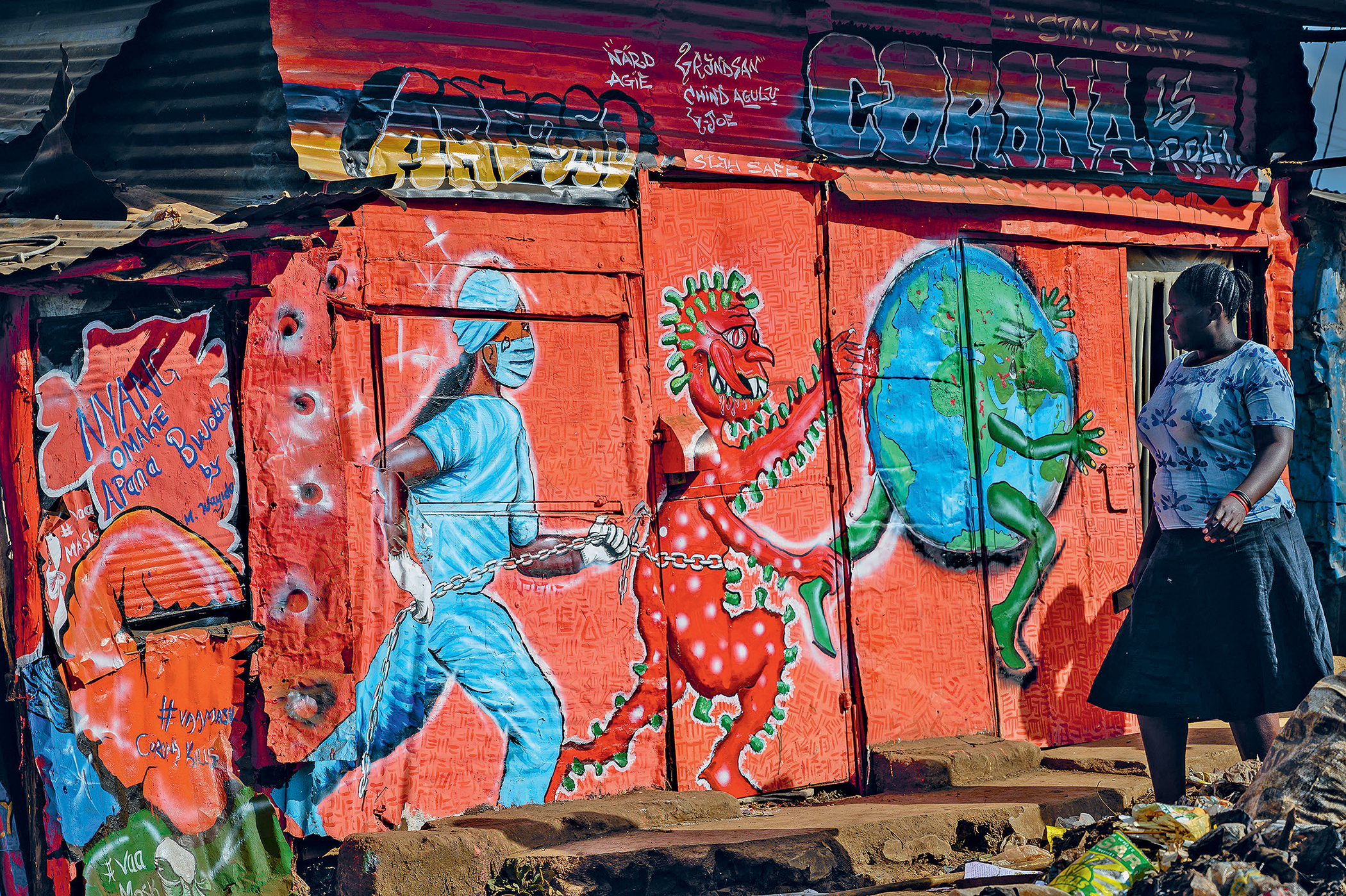 A local art group, art360, painted this mural dedicated to the fight against the virus in the settlement of Kibera, Nairobi, Kenya.