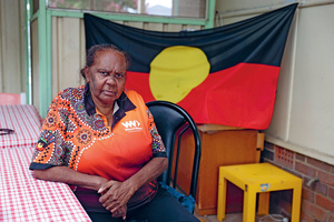 Stolen not silent: 66 years after being kidnapped and housed in a church mission, campaigner Rita Wright sits in her home in protest of colonial 'Australia Day' celebrations.Photo: Loren Elliott/Reuters