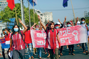 Esther Ze Naw and Ei Thinzar Maung lead the first large-scale protests against the coup in Yangon, 6 February 2021.Photo: Myat Thu Kyaw/NUR Photo/Getty