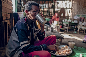 Breakfast in Berbera. A young man eats in a tea shop in one of Somaliland's coastal towns, which is drawing in former pastoralists who are re-training as fishers.Tommy Trenchard/Panos