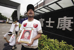 Death at Foxconn: Ma Zishan mourns his son Ma Xiangqian, the tenth protest suicide against draconian management at the south China electronics firm. The suicides continue.Joe Tan / Reuters