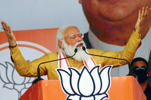 Image is everything: Indian Prime Minister Narendra Modi on the campaign trail prior to the West Bengal elections, March 2021, which his party lost. The huge rallies by all parties were criticized for their irresponsibility during India's coronavirus crisis. Photo: SIPA USA/ALAMY