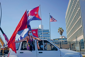 Protesters against the US trade embargo on Cuba drive past the US Embassy in Havana in a motorcade, 28 March 2021. Photo: ALEXANDRE MENEGHINI/REUTERS