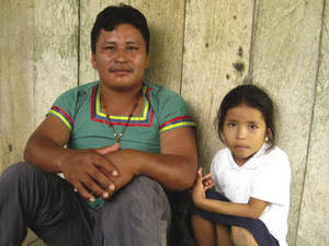 Building an alternative to oil: Meliton Yumbo, pictured with his daughter Serley, is the leader of the Kichwa community that owns the Napo Wildlife Centre, inside Yasuní National Park.