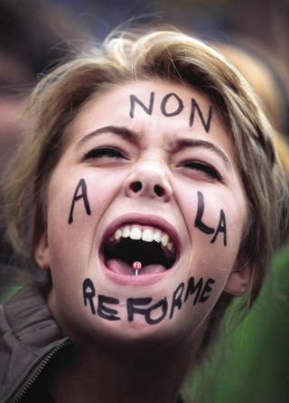 'Non a la réforme' means no to the age of austerity in France, as a student protests against a rise in the pension age in October 2010.