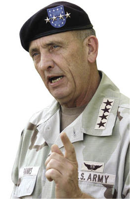 US General Tommy Franks telling it like it isn't to journalists at Bagran airbase, Afghanistan.