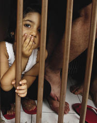 Behind bars: An Iranian child held in detention.Sigit Pamungkas / Reuters