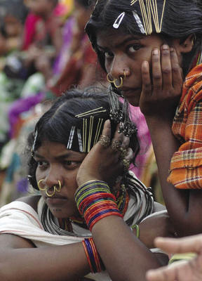 Kondh tribal women listen to a speech by Congress Party leader Rahul Gandhi on the day the government said no to Vedanta.Biswaranjan Rout/AP/Press Association Images
