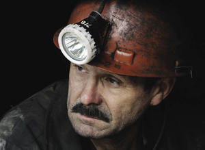 Looking ahead in Stalin's own country: a miner waits for his shift in a coalmine in the town of Tqibuli, near Kutaisi.