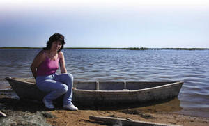 Marina Grishina by the waters of the Small Aral Sea. The island of her childhood holidays is now a dustbowl.