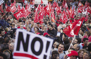 Spanish demonstrators march in Madrid in September 2010 as part of a general strike to protest against government spending cuts.Paul White / AP Photo