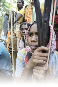 Adivasi women of Lalgarh - a Maoist-domained region - attend meetings armed, following police attackson them. Pintu Pradhan