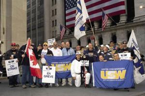 Steelworkers from Canada and the US support striking mine workers outside Brazilian mining company Vale Inco's headquarters on Wall Street.