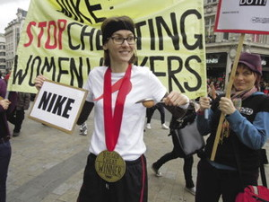 Activists outside a London store award Nike the title of 'biggest cheat' for using exploited women workers in its factories abroad.UK Feminista