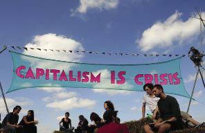 Climate camp activists at Blackheath: 'We recognize that the causes of climate change are systemic.'Toby Melville / Reuters