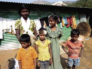 Where next? Displaced children outside their temporary shelter.Tarsh Thekaekara