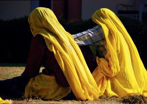 Women weed the gardens at Sariska Palace in Rajasthan, India.
