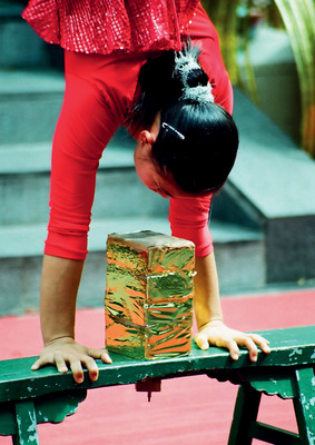An acrobat performs in the middle of a square in Chinatown, Singapore.