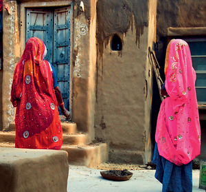 Local women plaster the walls of a hut in Mandawa, Rajasthan.