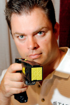 Be very afraid: Taser International co-founder Tom Smith has you in his sights.